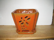 "LOTUS64  Lotus Pot orange square 7"" x 7"" high"